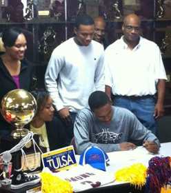 Athletes First James Woodard of Edmond Memorial High School signs a letter of intent to the University Of Tulsa